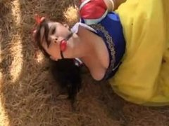 Snow White hogtied in the woods