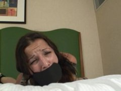 Nice struggle on the bed in Armbinder and leather gag