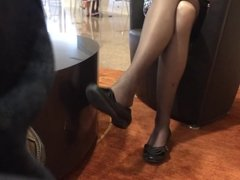 Mature business woman shoeplay in nylon
