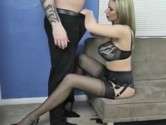 Busty blonde in black lengerie blows cock slowly