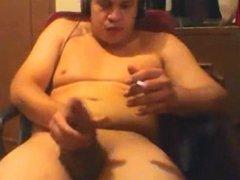Chunky dude stroking in slowmo