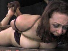 Hogtied busty slut in bastinado session