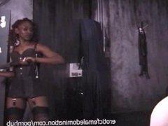 Black mistress enjoys dominating three helpless white girls at once
