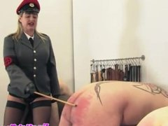Femdom domina disciplines defiant subs with her cane