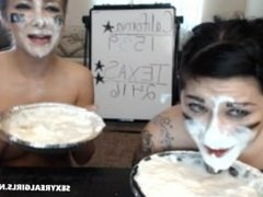 2 Girls eating a creamy pie
