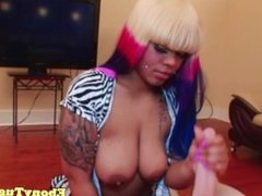 Chubby ebony tugs dick with her big boobs out