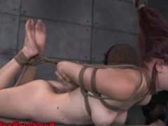 Submissive slut hogtied and caned by dom
