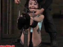 BDSM sub wrapped in chains and spanked