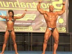 Bodybuilding couple with fighting scene