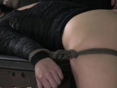 Gagged submissive tied up by dom