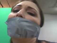 Women bound and gagged with duct tape by one women with mask