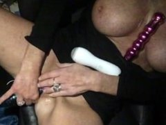Sexy Lady Di 34DD in a car with her toys