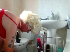 sissy ken rides his dildo in bathroom in chastity