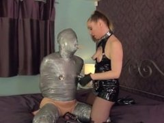 Naked guy well bound and gagged with duct tape by a woman who masturbates