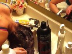 Redhead forward hair wash