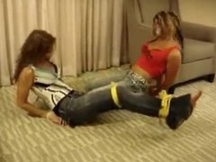 2 girls bound and tape gagged