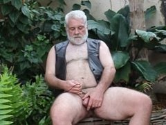 Big polar bear jerking outdoor