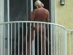couple fuck on balcony