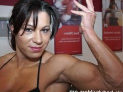 sexy brunette muscled young lady flexing and posing