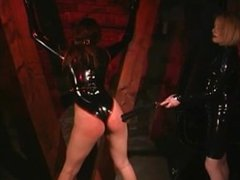 Latex Mistress and her young Slave Girl