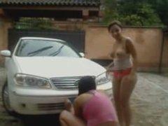 2 latin girls washing the car in the webcam