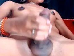 Latin shemale with small tits is jerking off