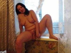 mature chick with big tits, masturbating on the windowsill!
