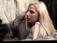 teasing that toy cock in her fur coat