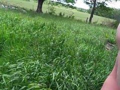 Cumming beside a farmer's field