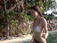 Young Asian Girl in Sexy Bikini at a Swimming Pool