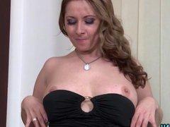 Brunette MILF masturbating on the pouffe