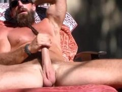 Hung bearded Long haired straight muscle dude jerks off and cums in the sun