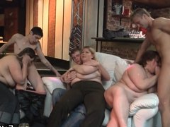 Chubby party girl rides cock on the couch