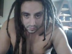 Beefy dreadlock dude jerk and cum on cam