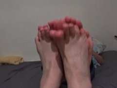 best friends playing footsies soles to soles
