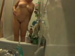My busty Mother showering in the evening