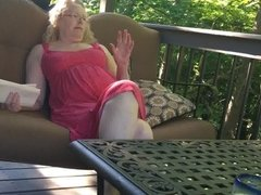 Sexy mother in law with bare feet and painted toes