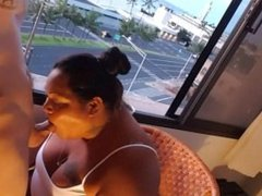 BBW MILF blowing cock in front of a window