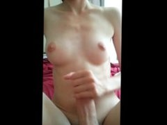 She strokes his cock until he cums on her