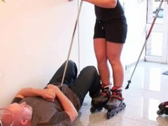 Blonde sisters trample guy with rollerblades and poke him with sticks