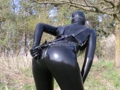 Hot spring outdoor walk with pissing in latex catsuit