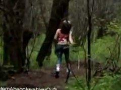 Merilyn Sakova running in the forest