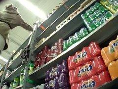 Supermarket upskirt girl in black tights
