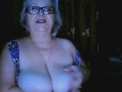 russian granny ex teacher flashing her big tits on webcam