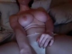 Busty Brunette Amateur Rolling her Clit while Watching Porn Movie