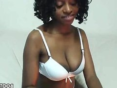 Busty black babe teasing on cam