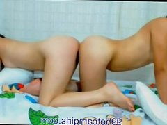2  girls share a double dildo