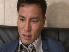 Handsome gay japanese in suit having fun and worship