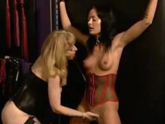 Nina Hartley sucks on Melissa Lauren's tongue