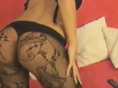 Sexy Blonde Rubs Fingers Herself in plush bedroom
